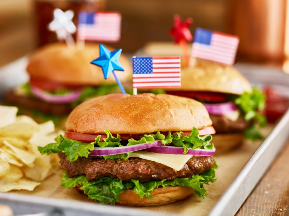 burgers and potato chips with american flags for Memorial Day